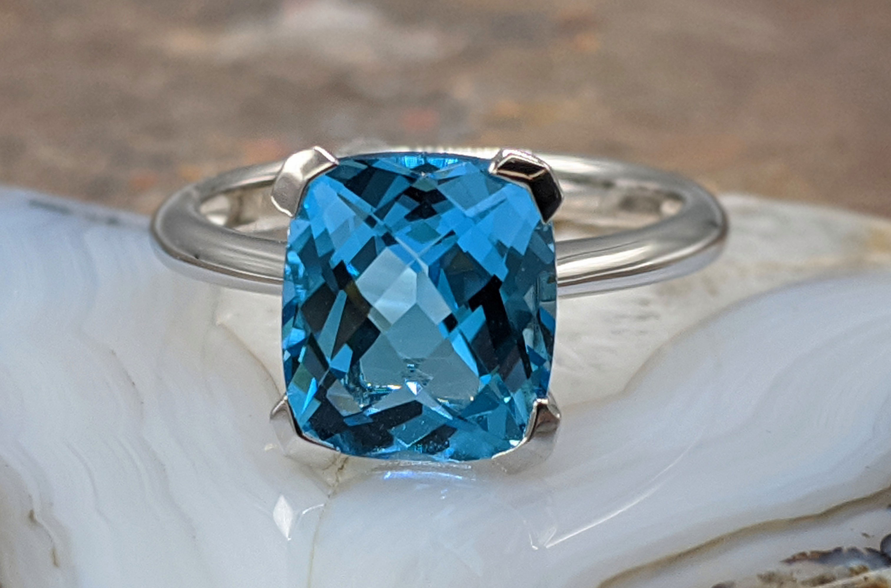 14 Karat White Gold Blue Topaz Solitaire Ring